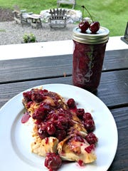 Homemade sour cherry chutney is served over grilled chicken.