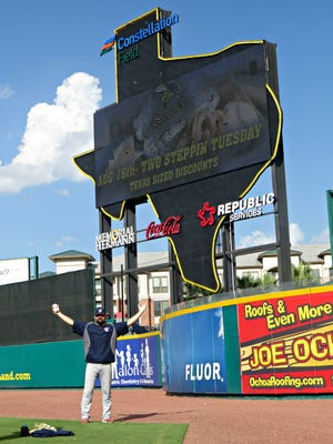 Cory Domel posing in front of Sugar Land's Texas-shaped scoreboard.