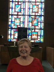 Marcelle Frost Crow in the sanctuary of the church.