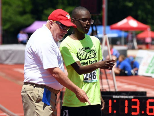 Griffith's Devin Brown receives instruction prior to the start of the 400 meter run during the Unified IHSAA track and field state finals at Robert C. Haugh Track and Field complex in Bloomington, Ind. on Saturday, May, 2, 2018.