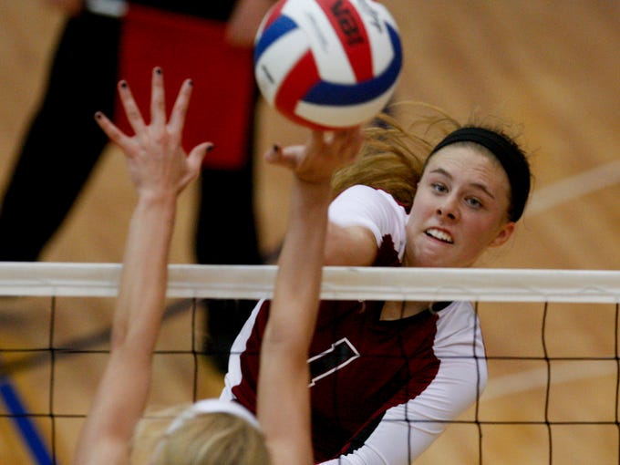 Assumption's Miranda Elpers, #1, gets a ball past Sacred Heart's Anna Zwiebel, #11, during their match at Valley High School.  Assumption won 3 games to 0.     Oct. 31, 2013