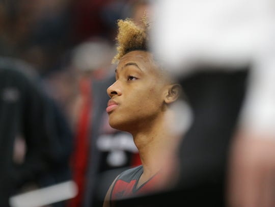 New Albany guard Romeo Langford (1) sits on the bench