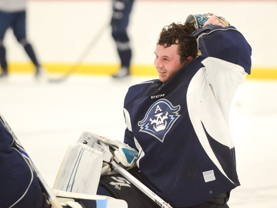 Troy Grosenick, a Brookfield native, talks with fellow goaltender Anders Lindback during Grosenick's first Milwaukee Admirals hockey practice Wednesday, February 28, 2018, at the Kern Center.