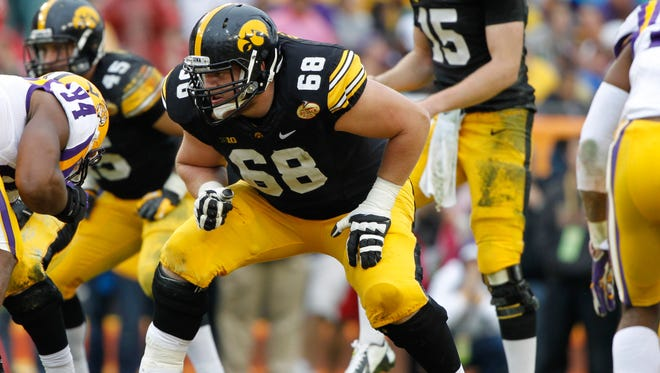 From 2013: Iowa Hawkeyes offensive linesman Brandon Scherff (68) lines up for a play against LSU Tigers in the 2014 Outback Bowl.