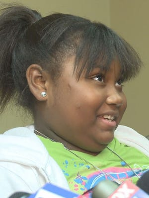 Erin Ingram, 13, was 8 years old when she lost her arm in a 2010 attack by two of her neighbor's pit bulls.