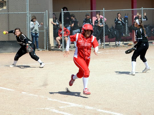 Loving's Candace Martinez tries to beat the throw to first base Saturday, March 19 against Portales. Martinez was named to the first all-state 3A team.