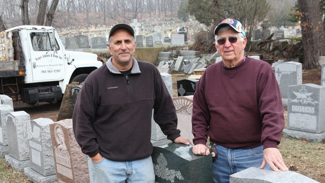 Roger Abbate Jr., and his father Roger Abbate Sr. stand April 7, 2014 among monuments at their business  Roger Abbate & Sons, Inc., which makes grave tombstones and markers.