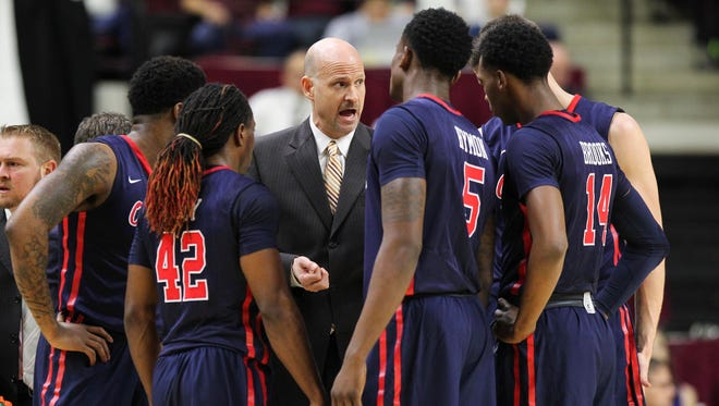 Coach Andy Kennedy speaks with his players during a timeout last week against Texas A&M. Despite some struggles, Kennedy believes the Rebels have a chance of reaching the NCAA tournament.
