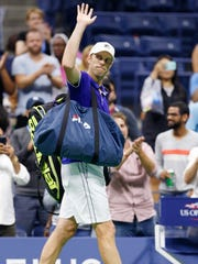 Thousand Oaks High graduate Sam Querrey waves to the crowd as he leaves the court following his four-set loss in the quarterfinals of the U.S. Open late Tuesday night.