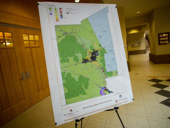 A map of Doña Ana County shows development zones within