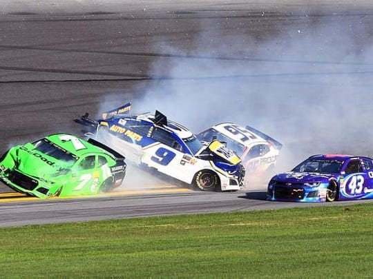 Feb 18, 2018; Daytona Beach, FL, USA; NASCAR Cup Series driver Danica Patrick (7) with driver Chase Elliott (9) and driver Kasey Kahne (95) wreck out of turn three during the Daytona 500 at Daytona International Speedway. Mandatory Credit: John David Mercer-USA TODAY Sports