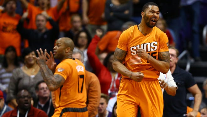Suns forward Marcus Morris (right) and P.J. Tucker react after a second half foul call against the Houston Rockets at US Airways Center. The Rockets defeated the Suns 113-111.
