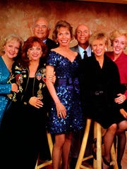 The cast of 'The Mary Tyler Moore Show' reunited for an episode of TV Land's 'Hot in Cleveland' in 2013. Moore made a pair of appearances on the show featuring her old co-star Betty White. (From left; White, Valerie Harper, Ed Asner, Mary Tyler Moore, Gavin MacLeod, Cloris Leachman and Georgia Engel)
