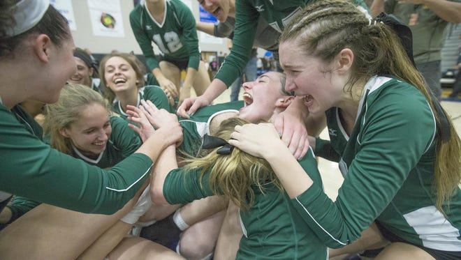 Sunnyslope High players celebrate their Division II girls volleyball state championship against Ironwood Ridge High in Gilbert in 2014.