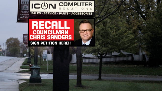 The electronic sign outside Icon Computer Solutions in Wayne is promoting the recall of Councilman Chris Sanders.