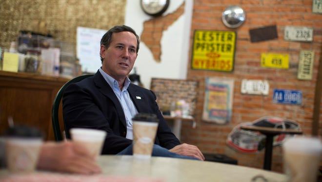 Republican presidential candidate, former Pennsylvania Sen. Rick Santorum meets with voters at The Corner coffee shop, on Tuesday, Jan. 19, 2016, in Greenfield, Iowa.