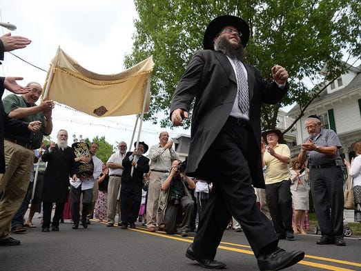 Rabbi Yitzchok Kahan of Chabad in Medford (right) precedes