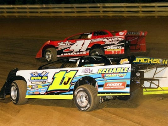 Andy Anderson (41), top, pulls away from Keith Jackson early in Saturday's Late Model race at Hagerstown Speedway. Anderson went on to win his fifth race of the season, all since June 6.