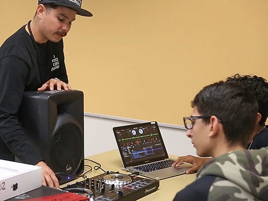 Rafael Lopez (aka Alf Alpha) works with high school students during a class on DJ'ing at Desert Hot Springs High School, February 20, 2017.