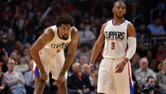 Los Angeles Clippers center DeAndre Jordan and guard Chris Paul (3) react during the first half against the Denver Nuggets.