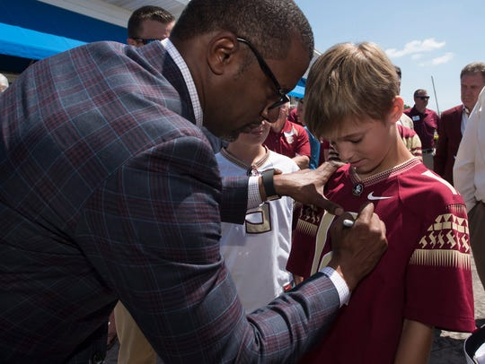 Florida State Football Coach, Willie Taggart, left,