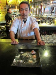 Chef Michael Woodall of Bistro 7 likes the way infused