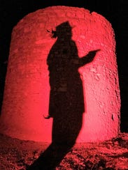 The silhouette of staff member  Kenneth Walter as a gunslinger was cast on The Torreon in Lincoln.
