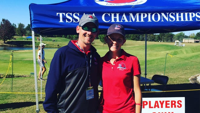Creek Wood High golf coach Johnny Palmore and CW junior Cindy Williams get set for their first day at last week's state AA golf tournament.
