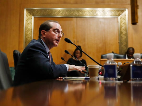 Alex Azar testifies during a Senate Finance Committee