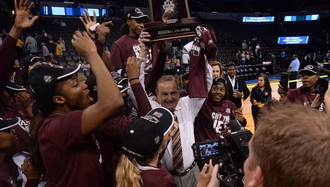 Mississippi State Lady Bulldogs head coach Vic Schaefer hoists the trophy after defeating the Baylor Bears in the finals of the Oklahoma City Regional of the women's 2017 NCAA Tournament at Chesapeake Energy Arena.