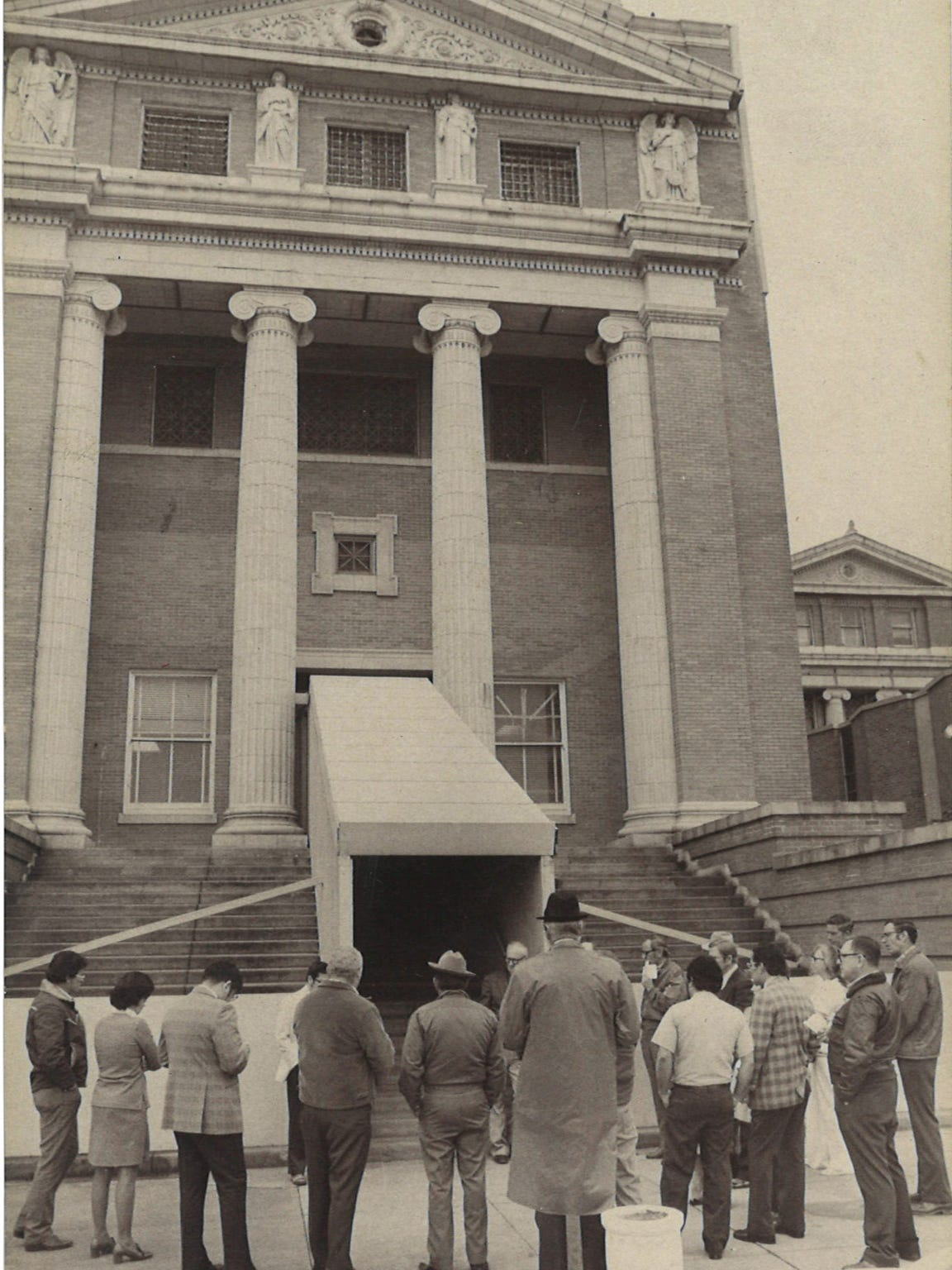 In 1972, the county constructed a wooden walkway into the Nueces County Courthouse to protect people entering and exiting the building from falling masonry.