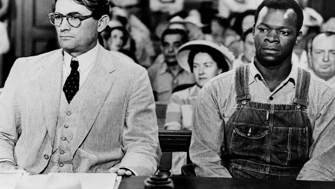 "Atticus Finch, played by Gregory Peck, represents a falsely accused black man named Tom Robinson, Brock Peters, in court during the 1962 film version of ""To Kill a Mockingbird."""