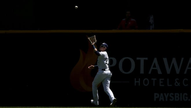 Christian Yelich catches a fly ball in the first inning against the Chicago Cubs at Miller Park on May 27 at Miller Park, with the Potawatomi Hotel & Casino sign visible in the background.