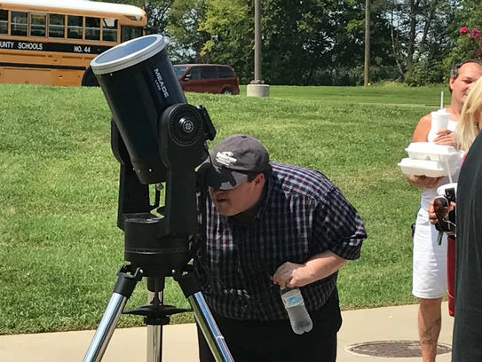 Scott Taylor looks through a telescope at HCC during