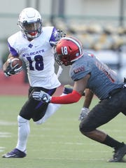 ACU's Justin Miller, left, attempts to stave off Incarnate Word's Cam Knight after a catch during their Southland Conference game Saturday Sept. 30, 2017 at Benson Stadium in San Antonio. ACU won 45-20.