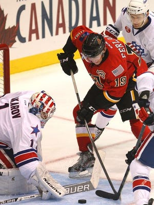 Michael Ferland of the Flames can't get this shot by goaltender Andrey Makarov of the Amerks.