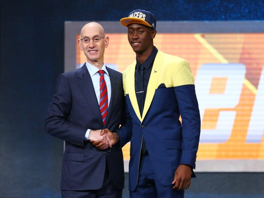 Jun 23, 2016; New York, NY, USA; Caris Levert (Michigan) greets NBA commissioner Adam Silver after being selected as the number twenty overall pick to the Indiana Pacers in the first round of the 2016 NBA Draft at Barclays Center. Mandatory Credit: Jerry Lai-USA TODAY Sports ORG XMIT: USATSI-269318 ORIG FILE ID: 20160623_jel_sl8_177.jpg