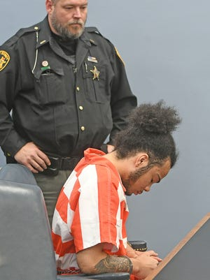 Lamont Lindsay awaits sentencing in Judge James DeWeese's courtroom Wednesday morning. Lindsay was convicted of was convicted of six counts, including attempted murder.