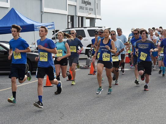 Runners at the Beach Goes Blue 5K take off on Saturday,