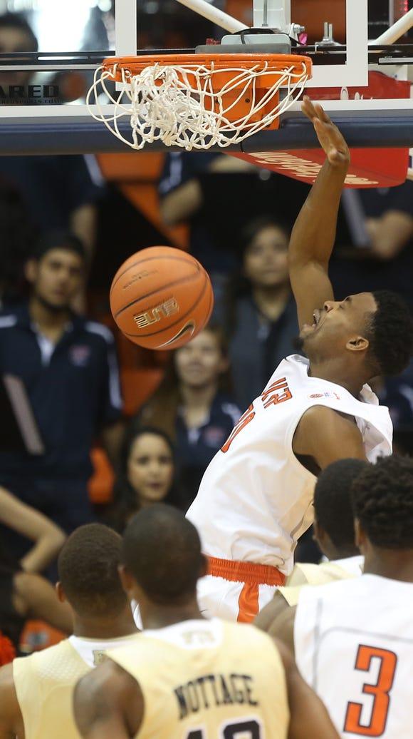 UTEP's Earvin Morris slam dunks during first half action