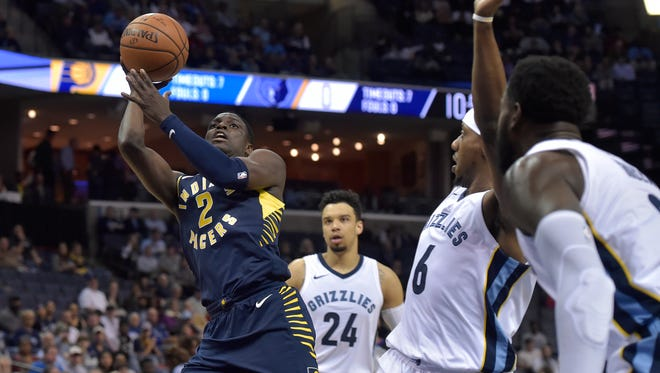 Indiana Pacers guard Darren Collison (2) shoots ahead of Memphis Grizzlies forward Dillon Brooks (24), guard Mario Chalmers (6), and forward JaMychal Green, far right, in the first half of an NBA basketball game Wednesday, Nov. 15, 2017, in Memphis, Tenn.