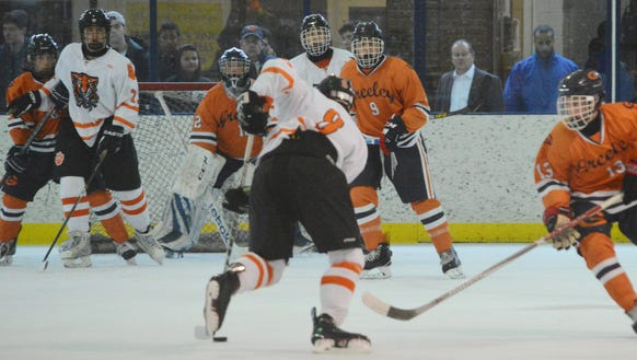 White Plains defenseman James Carrier has the attention