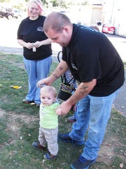 Noel Westfall, of Watkins Glen, plays with his 10-month-old