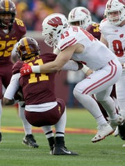 UWGRID UWGRID26 - Wisconsin Badgers linebacker Ryan Connelly (43) sacks Minnesota Golden Gophers quarterback Demry Croft (11) during the 2nd quarter of the Wisconsin Badgers vs. Minnesota Golden Gophers football game at TCF Bank Stadium in Minneapolis, Minnesota on Saturday, November 25, 2017. -  Photo by Mike De Sisti  / Milwaukee Journal Sentinel