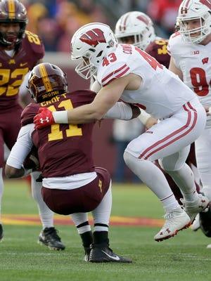 Wisconsin linebacker Ryan Connelly (43) sacks Minnesota quarterback Demry Croft in the second quarter Saturday.