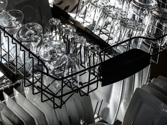 Dishwasher after cleaning process.
