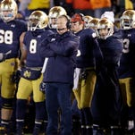 Notre Dame head coach Brian Kelly watches his team in overtime of Saturday's 43-40 loss to Northwestern in South Bend, Ind.