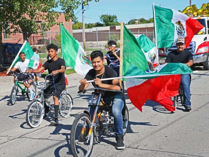 A group of people on bicycles participate in the Mexican