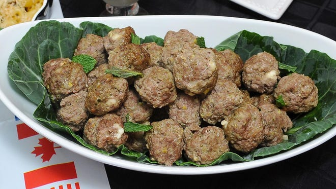 These meatballs, made with lamb and beef, have pesto in them but are also served with pesto on the side as well as a tangy yogurt sauce. The recipe is from Great Host Karen Wilets.