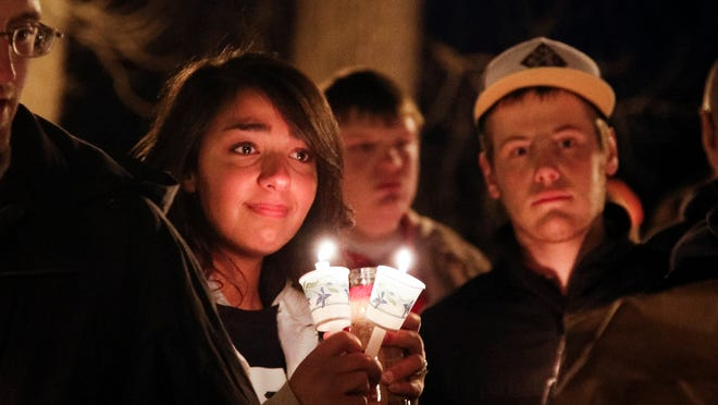 Over 200 people gathered to remember Deven Guilford at Island Park in Grand Ledge.
